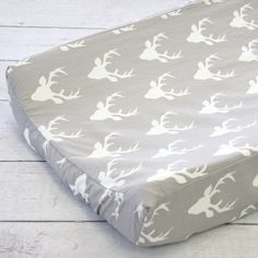 Going with a woodland theme in your nursery? This changing pad cover might be the perfect fit!