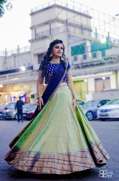 Light Lehengas - Green and Blue Lehenga | WedMeGood | Bride in a Light Green Lehenga with a Blue Embroidered Choli and Net Dupatta #wedmegood #indianbride #indianwedding #twirling #choli #lehenga #brocade