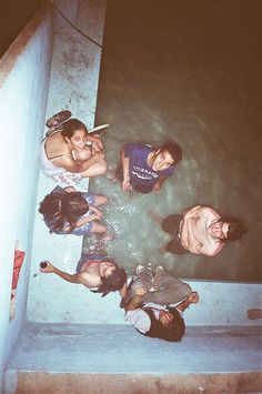 teenagers sneaking into a hotel swimming pool in the night