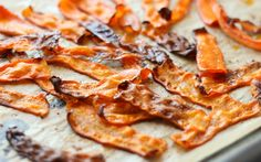 <p>This carrot bacon is deliciously smoky and so easy to make. Thinly sliced carrot strips are marinated in a blend of oil, garlic powder, and smoked paprika, then baked until wavy and slightly crisp.</p>