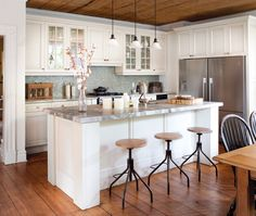 Beautiful bright kitchen with sink in island - not a fan of the stools but Love the wide plank wood floors! Kitchen Design, White Modern Kitchen, Wood Ceilings, Kitchen Inspirations, Kitchen Decor, Farmhouse Kitchen Inspiration, Bright Kitchens, Flooring, House Flooring
