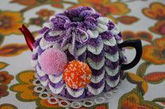 Crochet TEA COSY with pom poms.    http://www.etsy.com/listing/84966015/crochet-tea-cosy