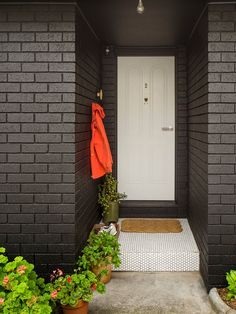 Graphic Modernism in Melbourne | Design*Sponge Spray-painted black brick. Inexpensive transformation.