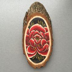 Wood slice with an original drawing of a peony door Inkspirednl