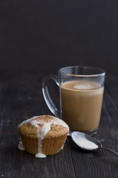 A low carb cappuccino muffin with a small cup of espresso