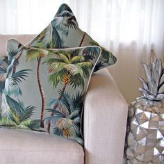 I love all things that remind me of the tropics... not the silly cartoonish stuff that you see in tourist stores bur rather things just like these accent pillows.  :)