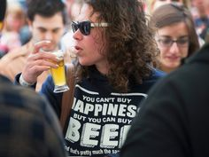 Beer lovers sample offerings from brewers at the American Beer Classic craft beer festival at Soldier Field on May 9, 2015 in Chicago, Illinois. The annual festival attracts about 10,000 guests. U.S. store sales of craft beer surged 11.8 percent in 2014 and have gained 2.7 points of market share in the past four years. Large beer makers still dominate the industry but they have been trying to shore up sliding sales by purchasing craft breweries. (Photo by )