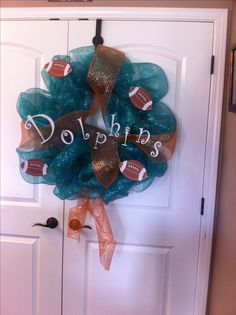 NFL Miami Dolphins mesh wreath add a bit more orange and then you don't need to worry about logo changes =)