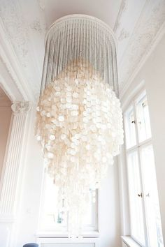 Amazing large capiz shell chandelier in traditional white space.