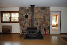 wood stove and stone chimney