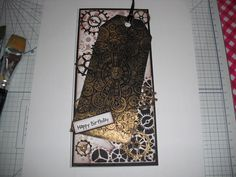 Tag from Crafters Companion Victorian Steampunk. Used gold gilding wax. Background Tim Holtz stencils. Cog dies from Sizzix
