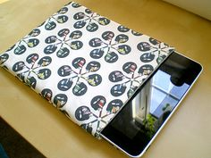 Padded iPad Sleeve Tutorial. I'm gonna attempt this...without a sewing machine. Wish me luck. I don't sew at all! Update: So I couldn't do it without the sewing machine. Borrowed one and after several mistakes and tries...made it! Super easy now that I got the hang of it.