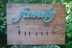 """This """"Family String Art Picture Holder """"sign is a wonderful addition to your home or would make a great gift for a family member, friend,"""