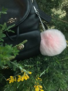 A personal favorite from my Etsy shop https://www.etsy.com/listing/506510951/pink-faux-fur-pom-keychain