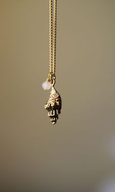 Our PJ57 Necklace in honor of my mother available in gold or silver.  #shell #conch #rosequartz #breastcancer #gemstone