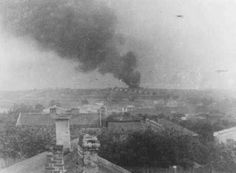 View of Majdanek extermination camp from a nearby village. The smoke is from the burning of corpses. Poland, October 1943.