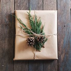 Natural Christmas gift wrapping with pine cones and cedar sprigs Beaded Christmas Ornaments, Christmas Wreaths, Christmas Crafts, Christmas Decorations, Christmas Christmas, Gift Wrapping Bows, Christmas Gift Wrapping, Jolly Holiday, Holiday Fun