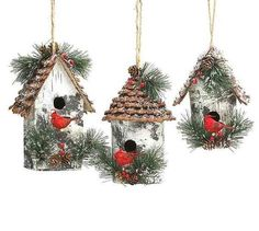 Rustic birdhouse ornaments feature vivid cardinals and fluffy greens with natural jute hangers. With textured pine cone roof, these large ornaments make thought