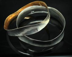 a brace of anticlastic bangles that seem to be made for each other....  www.jonathandeer.co.uk