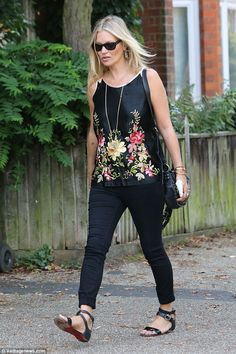 Pretty as a petal:Clad in a satin top with floral embellishment, Kate Moss, 42, looked chic and colourful as she headed out to lunch with her friends in London on Tuesday