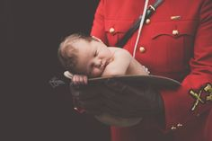 newborn session - daddy is a police officer. baby in his daddy mounty police hat