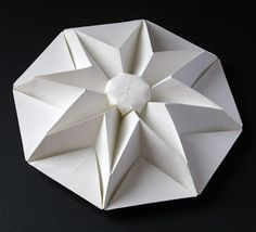 Origami: Star Puff. Designed and folded by Francesco Guarnieri, January 2012. http://guarnieri-origami.blogspot.it/2012/12/star-puff.html