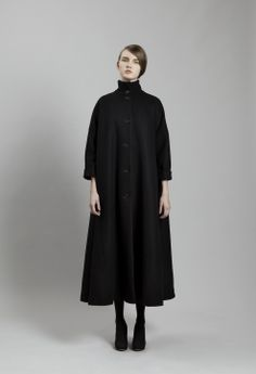 an elegant twist on the classic black coat. particularly love the high neck and a-line cut.