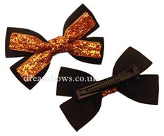 www.dreambows.co.uk Black and gold glitter ribbon hair bows on alligator clips, crocodile clips, black hair bows, glitter hair bows, sparkle hair bows #glitter #sparkle #blackbows #style #fashion #hair #hairbows