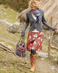 Gray cardigan with red flowered skirt.