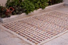 This is a Tunisian Vintage Style Handwoven Margoum Kilim Rug, made with natural wool in berber style. Showcasing Berber multicolore patterns on a Beige Background and a medium raw surface finishing. Beige Background, Berber Rug, Kilim Rugs, Bohemian Rug, Hand Weaving, Wool, Pattern, Handmade, Vintage