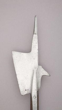 Halberd Date: 15th century Culture: Swiss Medium: Steel, wood (oak), iron Dimensions: L. 73 in. (185.3 cm); L. of head 16 1/4 in. (41.2 cm); W. 8 in. (20.3 cm); Wt. 7 lbs. 5.3 oz. (3325.4 g)