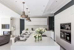 6 bedroom detached house for sale in Lancaster Gardens, Wimbledon Village, London, - Rightmove. Oak Cabinets, Kitchen Cabinetry, Open Plan Kitchen, New Kitchen, Wimbledon Village, Retro Lighting, Architecture Awards, Bar Seating, Open Plan Living