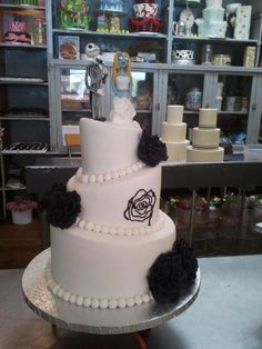 Charly's Bakery, Cape Town. Corpse Bride cake topper on topsy turvy white wedding cake with sugarpaste black roses