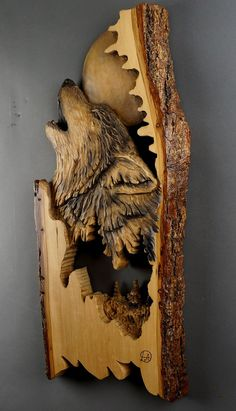 Wolf carved on wood carving wood with bark in Relief by DavydovArt