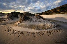 Beach calligraphy by Andrew van de Merwe