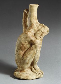 Vase in the form of a sleeping African (known as Ethiopian) boy, 3rd–2nd century b.c.  Terracotta   This sleeping boy's nakedness and exhausted state suggest that he is a slave or servant. Vases of this shape most likely held perfumed oils.