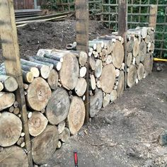 How we built our log retaining wall to hide two stumps and create a level, usable space at the top of our plot Terraced Backyard, Terraced Landscaping, Backyard Landscaping, Log Fence, Wattle Fence, Diy Garden Fence, Garden Beds, Backyard Projects, Garden Projects
