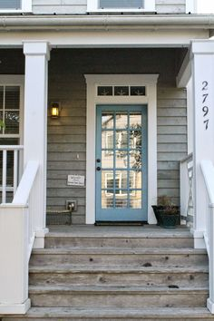 Great porch love the worn wood white trim and blue door! The Wicker House: Beach Cottages