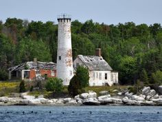 One of the saddest lighthouse sights on the Great Lakes - Lake Michigan's 1875 Poverty Island light station - one of four sisters including St. Helena, Tawas Point and Sturgeon Point.