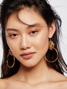 Lion's Den Knocker Earrings | Brass hoops featuring a simple, modern look with a fierce animal accent for added flare.