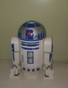 He plays cassette tapes as well as produces four sound FX by pressing the buttons on the bottom of his torso. His Red eye flickers when sounds are being played and he is a nice little player. Sound is crisp and loud and would make a nice gift for that star wars collector. | eBay!