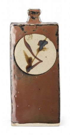 Hamada Shoji (1894-1978) <br />A square stoneware bottle vase, applied with a thick iron glaze and four roundels of grasses<br />23.3cm. high <br />