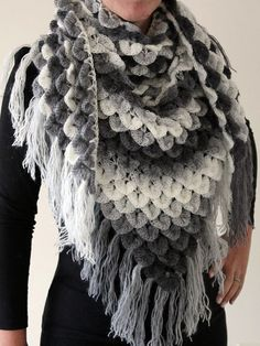 This gorgeous crochet cowl features a crocodile stitch body and flowing fringes for an ethereal look