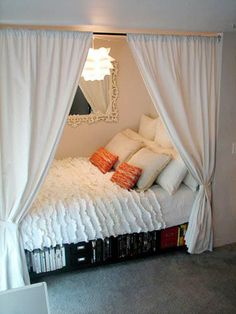 DIY instructions for creating your very own adorable bed nook! Plus: turn an IKEA LACK shelf into under-bed storage.