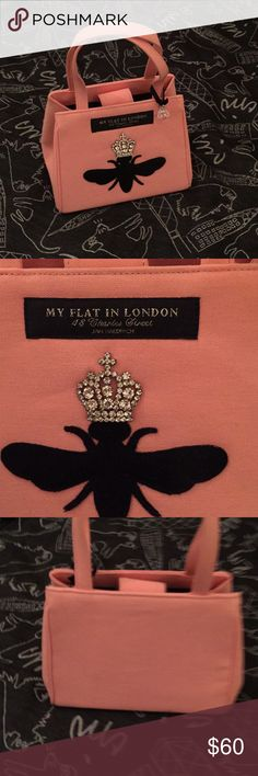 My Flat in London Handbag Cute pink bag with black bee and jewel for his crown.  Canvas material. Zipper compartment inside. Black lining.  Feet on bottom. Mark on clasp see pics My Flat in London Bags Mini Bags