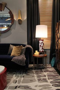 LURAY's side table corner, enlightened not only by AMIK table lamp and ECPLISE wall lamp, but also by BYSCAINE rug.    www.brabbu.com/casegoods/luray.html  www.brabbu.com/lighting/amik.html  www.brabbu.com/lighting/eclipse.html  www.brabbu.com/rugs/byscaine.html