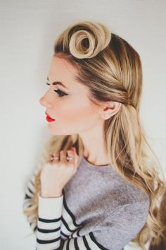 Add a bold pin curl to give your hair a vintage vibe.