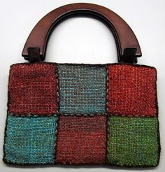 Ravelry: tr3n1ty's Noro Purse - made with a weave it loom