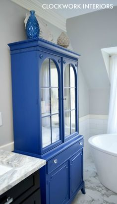 Painting an outdated china hutch and using it as bathroom storage / Clockworkinteriors.com
