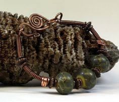 The beautiful Green Dragon Scales Bracelet is hand created with copper wire, coiled copper wire, 3 green dragon scale lampwork beads on an olive colored base, copper accent beads, a hand created forged clasp. Fits up to a 7 inch wrist, jump rings can be added to make it fit a larger wrist. This will be a gorgeous handcrafted bracelet to add to your jewelry collection.